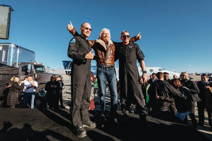 "Richard Branson celebrates with VSS Unity's pilots Mark ""Forger"" Stucky and Frederick ""CJ"" Sturckow. Image Virgin Galactic"
