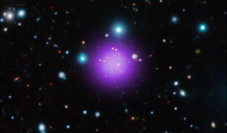 Galaxy cluster CL J1001+0220 is the most distant cluster ever discovered. This image is a composite of X-ray, infrared and radio observations from several telescopes. Credit: X-ray: NASA/CXC/CEA/T. Wang et al; Infrared: ESO/UltraVISTA; Radio: ESO/NAOJ/NRA
