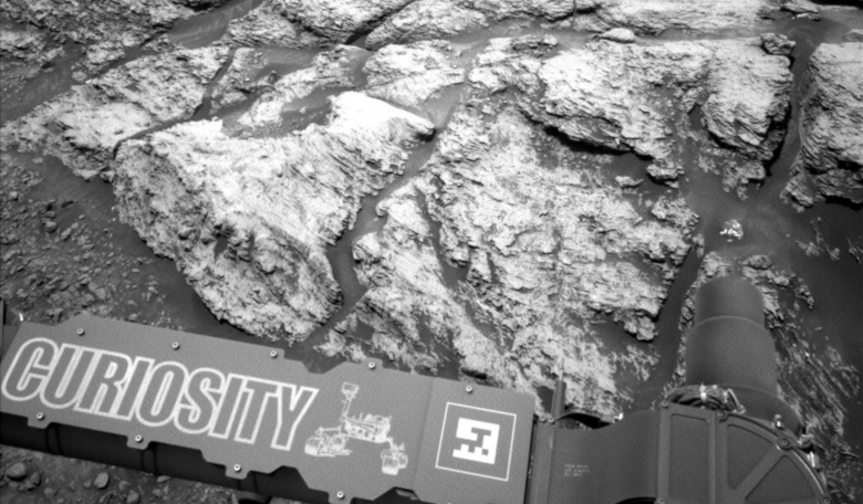 This image was taken by the left Navcam on NASA's Curiosity Mars rover on 18 June, 2019, the 2,440th Martian day, or sol, of the mission. It shows part of