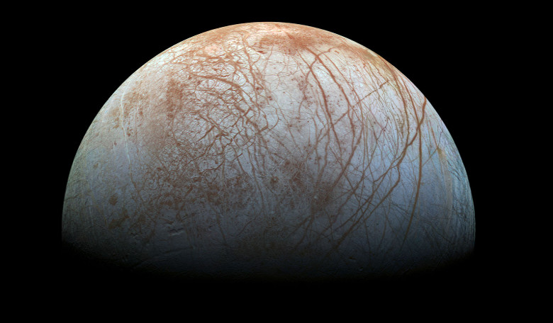 Europa looms large in this reprocessed color view, made from images taken by NASA's Galileo spacecraft in the late 1990s. Image credit: NASA/JPL-Caltech/SETI Institute