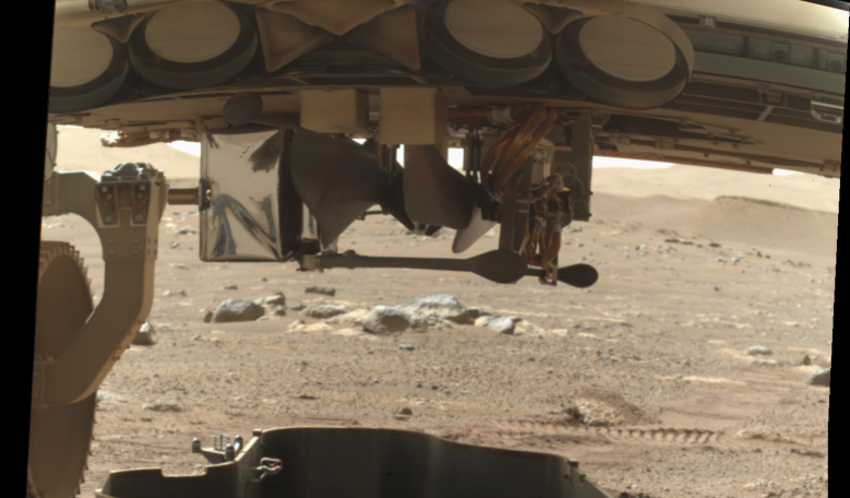 NASA's Perseverance rover just released the debris shield that protected the Mars helicopter during landing, giving the first glimpse of a rotorcraft on another planet. Image: NASA