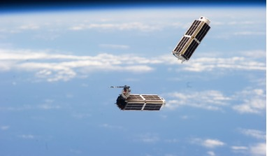 Flock 1 satellite constellation deploying from the International Space Station. Image: NASA/Planet Labs