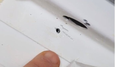 A photo of the hole in the Soyuz spacecraft's orbital module released by NASA.