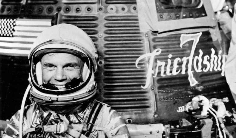 Astronaut John Herschel Glenn Jr, pilot of the Mercury Atlas 6 (MA-6) spaceflight, poses for a photo with the Mercury