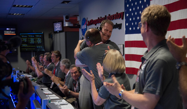 The Juno team celebrates at NASA's Jet Propulsion Laboratory in Pasadena, California, after receiving data indicating that NASA's Juno mission entered orbit around Jupiter. Image: NASA/JPL-Caltech