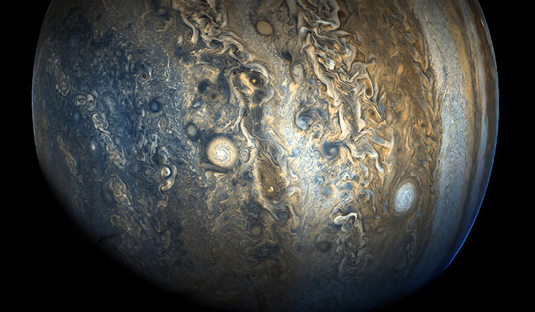 "A view of Jupiter's southern hemisphere that captures one of the white ovals in the ""String of Pearls,"" one of eight massive rotating storms at 40 degrees south latitude on the gas giant planet. Image: NASA/JPL-Caltech/SwRI/MSSS"