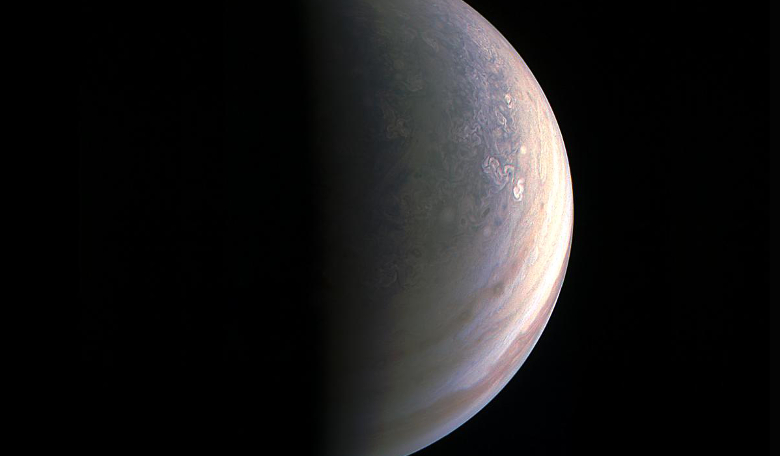 Jupiter's north pole as seen by JunoCam on its 27th Aug, 2016 flyby. Unlike the equatorial region's structure of belts and zones, the poles are mottled with rotating storms of various sizes. Image: NASA/JPL-Caltech/SwRI/MSSS