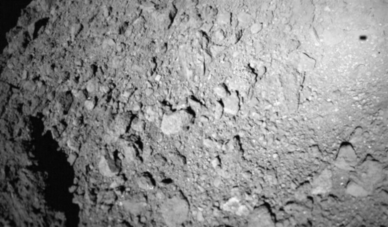 The MASCOT lander captured this image of asteroid Ryugu while descending to the asteroid's surface on 3 October, 2018. The lander's shadow is visible in the upper right. Image: DLR
