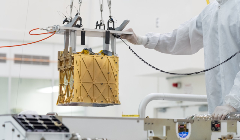 Technicians at NASA's Jet Propulsion Laboratory lower the Mars Oxygen In-Situ Resource Utilisation Experiment (MOXIE) instrument into the belly of the Perseverance rover. Image: NASA/JPL-Caltech