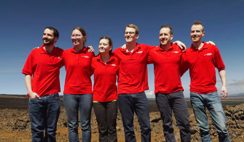 Crew members pose for a photo 17 September, 2017, after emerging from their habitat, after eight months of living in isolation in a Mars-like habitat in Mauna Loa volcano, Big Island, Hawaii. Image: University of Hawaii