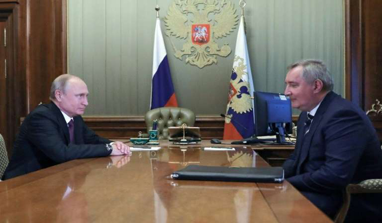 Russian President Vladimir Putin (left) meets appointed former deputy prime minister Dmitry Rogozin to head the country's space agency.