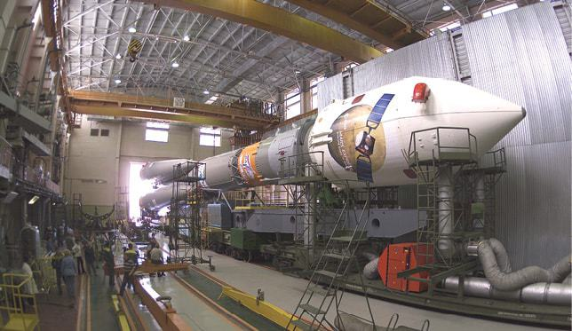 Soyuz-launch-vehicle-in-the-assembly-hall-at-Baikonur-cosmodrome.jpg