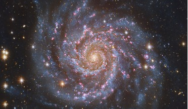 Dark Matter, fundamental forces, International School for Advanced Studies (SISSA), mini-spiral galaxies, standard model