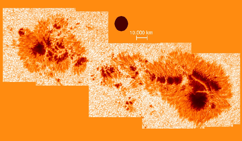 A large sunspot group observed with the Vacuum Tower Telescope (VTT) at the Teide Observatory. Note the light bridges crossing the dark centers (umbrae). The black circle corresponds to the size of the Earth. Image: KIS/VTT