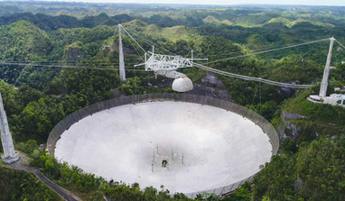 Arecibo Observatory, pictured here in the spring of 2019. Operations to fix the first break that occurred in August 2020 have been put on hold as engineers assess the new damage caused by a second cable snapping. Image: UCF