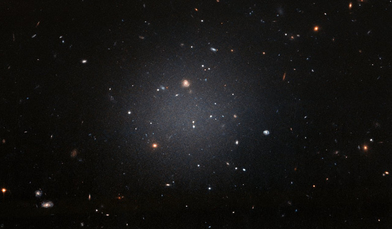NGC 1052-DF2 resides about 65 million light-years away in the NGC 1052 Group, which is dominated by a massive elliptical galaxy called NGC 1052. Image: NASA, ESA, and P. van Dokkum (Yale University)
