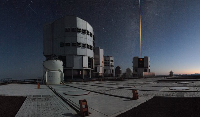 ESA's Very Large Telescope in Chile firing a laser from Unit Telescope 4, Yepun, to help the adaptive optics system of the telescope. Image: ESA