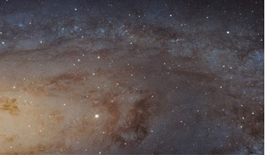 A sweeping bird's-eye view of a portion of the Andromeda galaxy (M31) by the Hubble Space Telescope. It is the sharpest image ever taken of our galactic next-door neighbour.