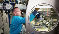 NASA astronaut Barry Wilmore setting up the Rodent Research-1 hardware in the Microgravity Science Glovebox aboard the International Space Station.