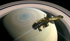 Cassini above Saturn's north pole during summer, with the hexagon and polar cyclone in view.