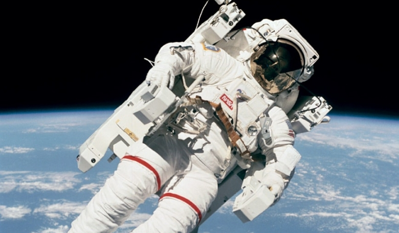 Bruce McCandless in free flight, participating in his historic extravehicular activity (EVA) with the Manned Maneuvering Unit from Space Shuttle Challenger.