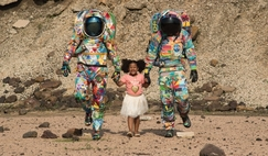 Exploring with art spacesuits Unity and Hope.