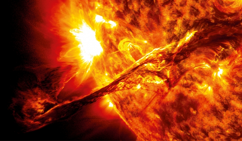 A coronal mass ejection caused by a huge electromagnetic explosion on the surface of the Sun. Such explosions send out billions of protons and electrons, in a superheated ball of plasma, into the solar system.