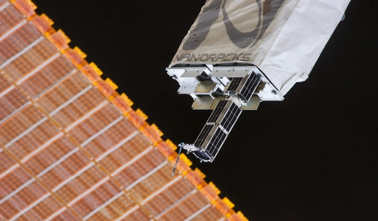 Planet Labs' Dove satellites being deployed from the NanoRacks CubeSat Deployer on the ISS in February 2014.