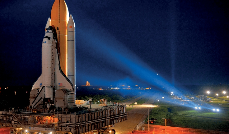 Space Shuttle Discovery rolls out to the launch pad for her final flight (STS-133).