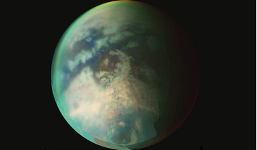 A composite taken during two separate Titan flybys. The large circular feature near the centre of Titan's disk may be the remnant of a very old impact basin.