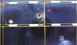 Solar cells removed during Hubble upgrades showing holes and craters from space debris impacts.