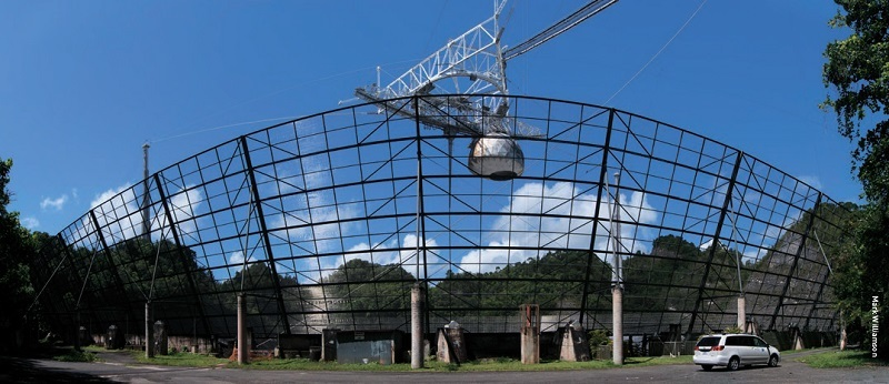 The 16 m tall 'ground screen' that surrounds the Arecibo telescope..