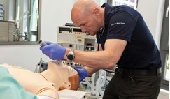 ESA astronaut Alexander Gerst practising his medical skills on a mannequin during pre-flight training.