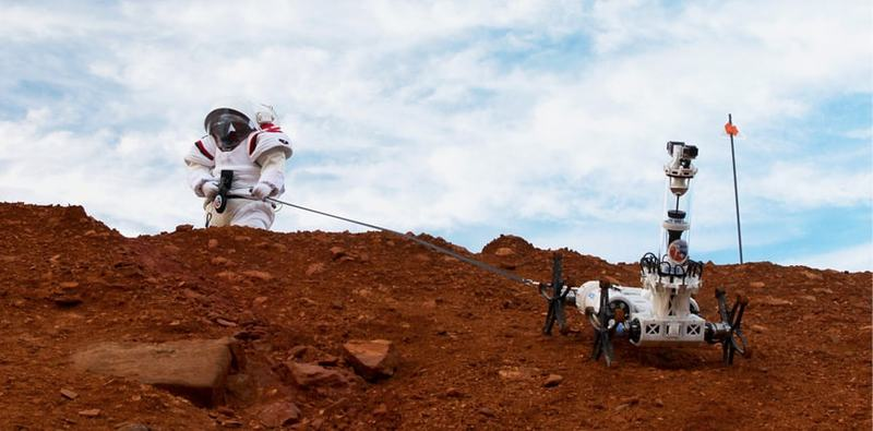 issue9-simulation-astronaut-supports-rover-on-a-steep-slope.jpg