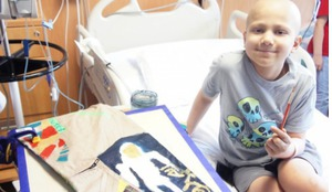Painting COURAGE - Space Suit Art Project patient visit at the University of Texas MD Anderson Cancer Center, Children's Cancer Hospital.