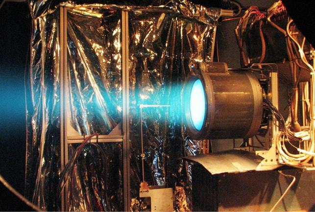 issue9-the-blue-exhaust-trail-of-an-ion-thruster-during-a-test-firing.jpg
