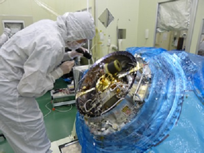 An instrument scientist inspects the Soft X-ray Spectrometer before its final closing. The instrument is one of four that will fly on the Japanese-led Astro-H mission launching in February.
