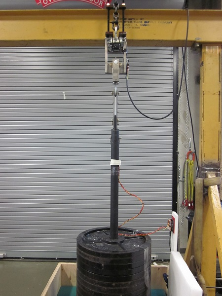 Test setup for molten rod release mechanism (with up to 30 x 20 kg stacked weight plates from athletics department)