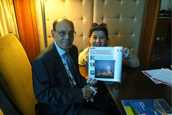 Ram Jakhu and Lena De Winne with the latest print edition of ROOM, IAC 2015, Jerusalem.