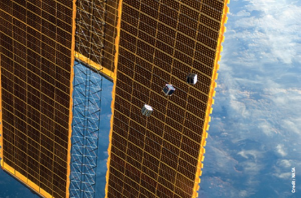 Tiny satellites called CubeSats are jettisoned from the International Space Station