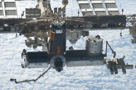 Seen at the bottom right, the experimental module Kibo is the largest on the International Space Station
