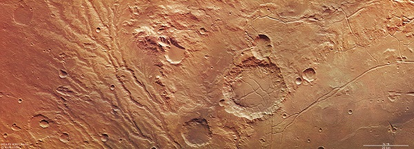 The Arda Valles region of Mars, comprising the network of drainage valleys seen in the left-hand portion of the image. The region lies on the western rim of an ancient large impact basin, which can be seen in the right-hand portion of the image.