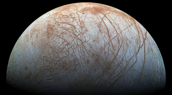 Diverse surface geology on Jovian moon Europa. Linear cracks and ridges crisscross the surface, interrupted by regions of disrupted terrain where the surface ice crust has been broken up and re-frozen into new patterns