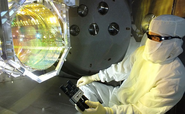 AA technician tests one of the suspended mirrors of the Advanced LIGO detector at Livingston, Louisiana