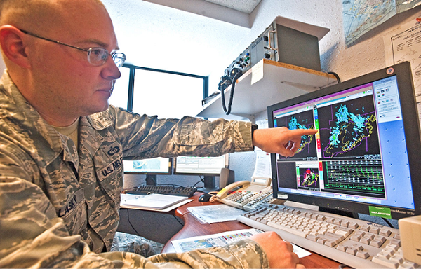 Staff Sgt Raymond Polasky points out changes in weather patterns on radar. The weather flight uses tools like weather sensors, satellites and radar to accurately forecast for eight different airframes