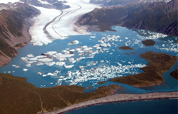 Climate change - an oblique aerial photograph showing the terminus of Bear Glacier, Kenai Mountains, Kenai Fjords National Park, Alaska, which is under continuous retreat